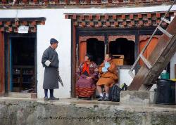 Village scene, traditional Bhutanese clothing and architecture, Bhutan