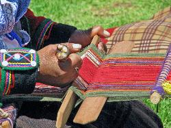 Hands of a Quetchua weaver, Urubamba valley, Andes Mts, Peru