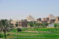 View of the Pyramids from the outskirts of the town of Giza, Egypt