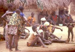 Village women and children watching a dance, Central African Republic