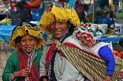 Quetchua mother with children, outdoor market at Pisac, Andes Mts, Peru
