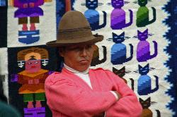 Quetchua woman selling textiles, outdoor market at Pisac, Andes Mts, Peru