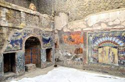 Interior of a room with a wall mosaic, Herculaneum, Italy