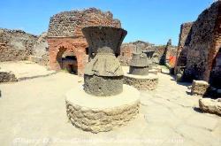 Gristmills and oven by an outdoor bakery, Pompeii, Italy