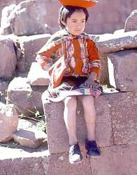 Quetchua girl in traditional dress, Andes Mts, Peru