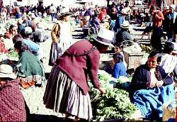 Women haggling, traditional outdoor market at Pisac, Andes Mts, Peru