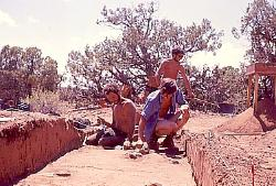 Archaeologists excavating a trench, Cedar Mesa, Utah