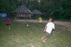 Soccer match in a jungle clearing near the Tambopata River, Amazon region