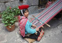 Quetchua textile weaver using a backstrap loom, Cusco, Andes Mts
